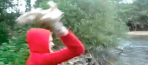 Woman throws puppies into river